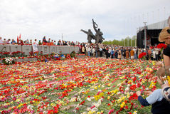 Celebrating of Day of a victor. Riga (Latvia). On May, 9th. Celebrating of Day of a victory over the second world war. Putting on flowers to a monument to Royalty Free Stock Images