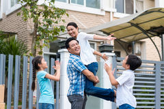Celebrating family. Happy Asian family celebrating after buying new house Royalty Free Stock Photos
