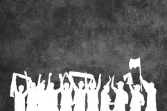 Celebrating fans with grunge wall. Silhouette of white cheering Football or Music Fans celebrating in front of grey grunge wall Royalty Free Stock Photo