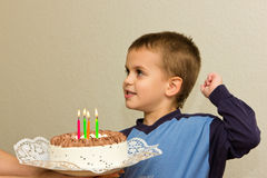Celebrating fifth birthday boy cake son blowing candle Royalty Free Stock Photos