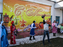 Celebrating folk holiday Maslenitsa in Russia. royalty free stock image