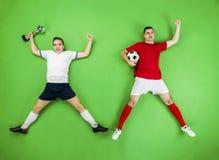 Celebrating football players Royalty Free Stock Image
