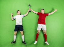 Celebrating football players Royalty Free Stock Images