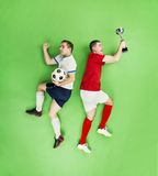 Celebrating football players Stock Images