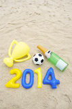 Celebrating 2014 Football Trophy Champagne Beach Royalty Free Stock Photography
