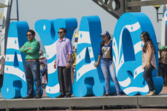 Celebrating foundation of Guayaquil, July 24. Guayaquil, Ecuador - July 24, 2014: People getting pictures at the Guayaquil sign located in Malecon Simon Bolivar Stock Image