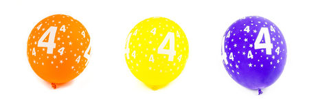 Celebrating four years birthday. Three multicolored inflatable balloons on white background Stock Photos