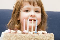 Celebrating fourth birthday Stock Photos