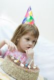 Celebrating fourth birthday Stock Image