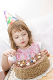 Celebrating fourth birthday Stock Photo