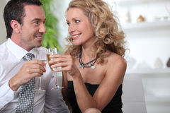 Celebrating with glass of champagne Royalty Free Stock Photo