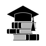Celebrating graduating hat and books. Education symbol Royalty Free Stock Images