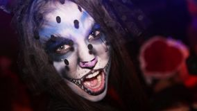 Celebrating Halloween in nightclub in costume