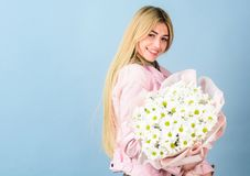 Celebrating her special day. Surprise for girlfriend. Adore flowers. Girl tender sensual blonde hold flowers bouquet. Flowers delivery service. Chamomile stock image