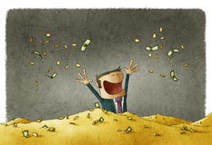 Celebrating his wealth in a pile of money Royalty Free Stock Images