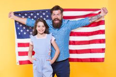 Celebrating the Independence every July 4th. Happy family commemorating anniversary of nations independence. Father and. Little child holding american flag on stock images