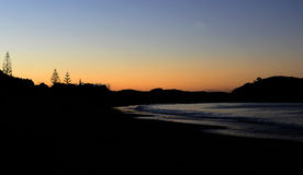Celebrating light and romance. Sun setting on a Northland Beach, New Zealand Royalty Free Stock Photos