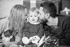 Celebrating love. Boxing day. Love and trust in family. Bearded man and woman with little girl. Happy family with stock photography