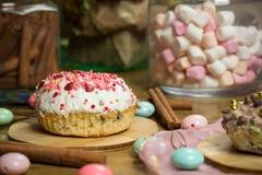 Celebrating marshmallow, cake, candies, fruit tea on wooden table, birthday Royalty Free Stock Photos