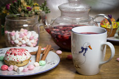 Celebrating marshmallow, cake, candies, fruit tea on wooden table, birthday Stock Photos