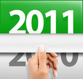 Celebrating new year 2011. Hand was pulling a page to celebrate new year 2011 Stock Image