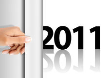 Celebrating new year 2011. Hand was pulling a page to celebrate new year 2011 Stock Photo