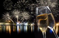 Celebrating New Year with champagne and fireworks Stock Photos