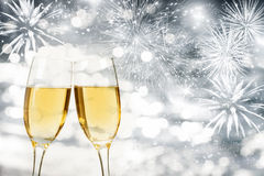 Celebrating New Year with champagne and fireworks royalty free stock photography