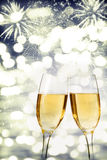 Celebrating New Year with champagne and fireworks Royalty Free Stock Images