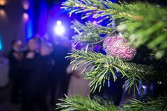Celebrating the new year and Christmas in the dance club. Unreco. Gnizable figures of gay people in blur Royalty Free Stock Images