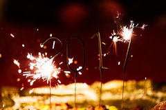 Celebrating the new year 2017 with flares Stock Photography