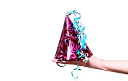 Celebrating New Years with colorful party hat royalty free stock photography