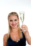 Celebrating new Years'Eve or Birthday. Beautiful blond woman celebrating New Year's Eve or Birthday Royalty Free Stock Images