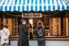 Berlin, October 03, 2017: Celebrating the Oktoberfest. People next to the counter choose products made in Berlin. royalty free stock photography