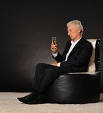 Celebrating senior businessman Stock Photography