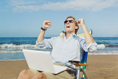 Celebrating Success at the Beach Royalty Free Stock Image