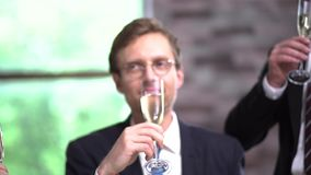 Clinking glasses with champagne at a business meeting. Celebrating Success With Champagne. Clinking Glasses With Champagne. Happy Businessman In Glasses Smiles stock video footage
