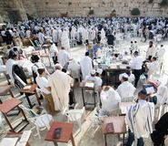 Celebrating sukkot at the Western Wall. Jerusalem, Israel - September 20, 2013: Jewish men gathered at the Wailing Wall in order to celebrate the Feast of Stock Photography