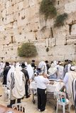 Celebrating sukkot at the Western Wall. Jerusalem, Israel - September 20, 2013: Jewish men gathered at the Wailing Wall in order to celebrate the Feast of Stock Photo