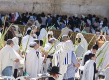 Celebrating sukkot at the Western Wall. Jerusalem, Israel - September 20, 2013: Jewish men and women gathered at the Wailing Wall in order to celebrate the Feast Stock Photography