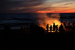 Celebrating the summer solstice. Young people at the celebration of the summer solstice on the shore of the Gulf of Riga. Latvia royalty free stock image