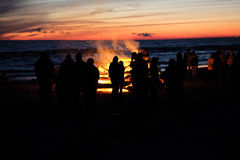 Celebrating the summer solstice. Young people at the celebration of the summer solstice on the shore of the Gulf of Riga. Latvia royalty free stock images