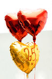 Celebrating 25th years anniversary golden label with ribbon and balloons, stock images