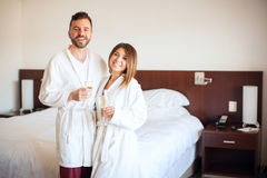 Celebrating their honeymoon in a hotel Royalty Free Stock Images