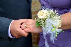 Celebrating wedding anniversary. A couple holds hands as they celebrate their wedding anniversary royalty free stock image
