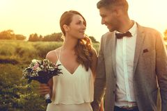 Celebrating wedding day. Couple celebrating wedding day outdoors stock image