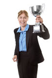 Celebrating a win. Business woman  wearing a suit with a blue shirt, is clutching hold of a trophy to celebrate her win Stock Photo