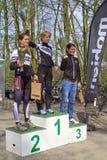 Celebrating on the winners podium. DORDRECHT, NETHERLANDS - APRIL 14 2012: Run Bike Run Bike Run duathlon event. Jolien Janssen, Ruth van der Meijden and Jolien royalty free stock images