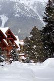 Celebrating winter. Ski resort in the middle of the mountains Royalty Free Stock Photos