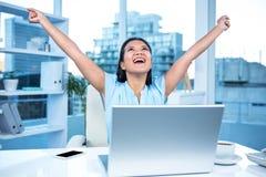 Celebrating woman with arms raised Stock Photos